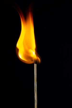 Flame on the matchstick over dark background Stock fotó