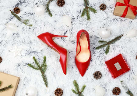 Womens red high heels shoes over white background. Christmas gift concept with place for text. Stock fotó