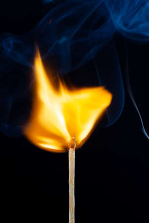 Flame and smoke on the matchsticks over dark background Stock fotó