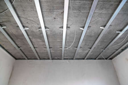 Ceiling structure gypsum. Structure of Ceiling suspended of drywall construction on interior house Stock fotó