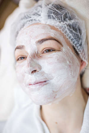 Woman with facial mask. Facial treatment in a spa center. Stock fotó