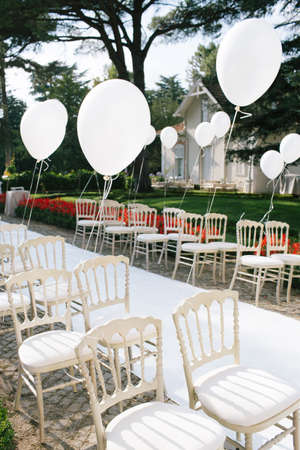 Wedding area chairs and balloons.