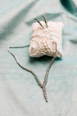 The bride's necklace. Wedding preparations. Bridal accessories.