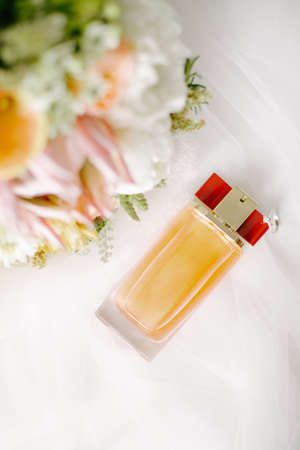Bridal flower and perfume bottle. On a white background. Stock Photo