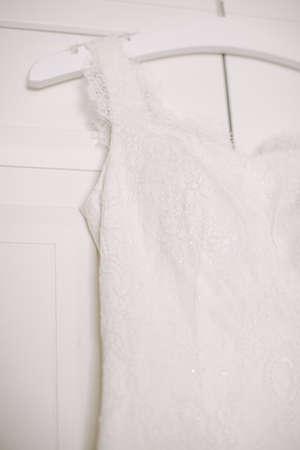 Wedding dress hanging on the wardrobe. Reklamní fotografie