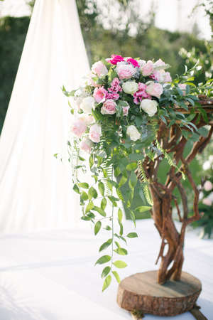 Wedding arch. Rustic wedding. Wedding area covered with flowers.
