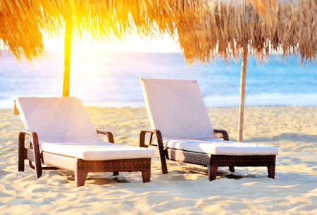 resort beach: Two beach chairs with white umbrella