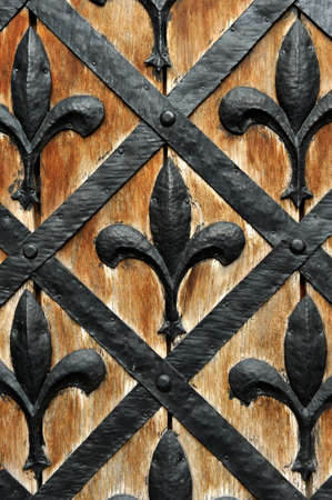 Part of a door of old castle. Wood and metal photo