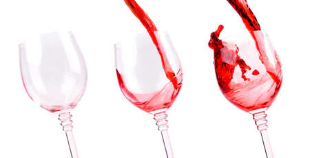 red wine pouring into wine glass photo