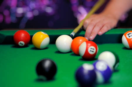 pool balls: Billiard balls in a green pool table Stock Photo