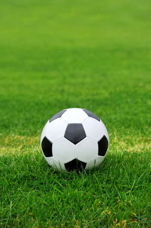 Close-up soccer ball on green grass photo