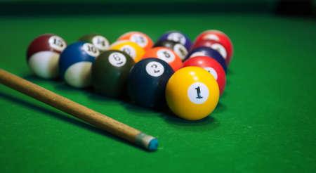 billiards halls: Billiard balls in a green pool table Stock Photo