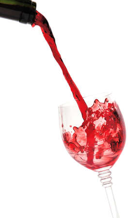 red wine pouring: red wine pouring into wine glass Stock Photo