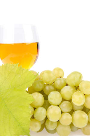 viniculture: Branch of grapes and glass of wine isolated on white background