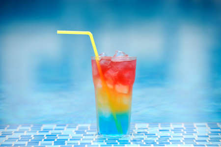 pool party: Colourful cocktail on the background of the swimming pool