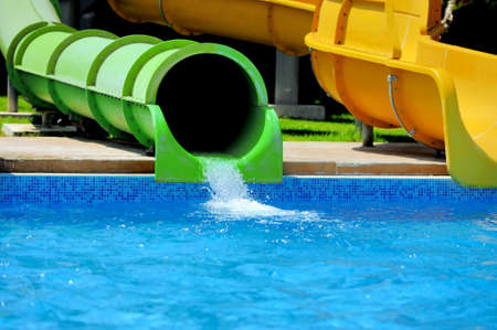 splashing water: Colorful water slides at the water park