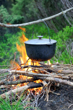 soup kettle: Cooking in the nature. Cauldron on fire in forest