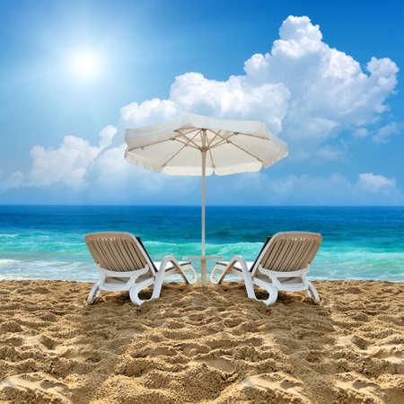 white sand beach: Beach chair and white umbrella on sand beach