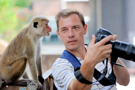 sandakan: Photographer shows a monkey by her photo shoot