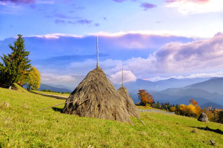 Traditional haystacks from a mountain village in mountains