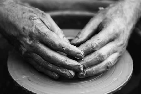 master: Hands of a potter. Potter making ceramic pot on the pottery wheel Stock Photo