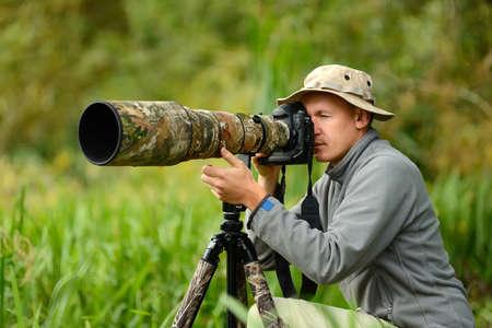Professional wildlife photographer outdoor Stock Photo