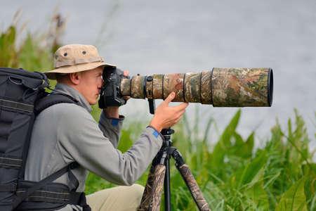 Professional wildlife photographer outdoor Lizenzfreie Bilder