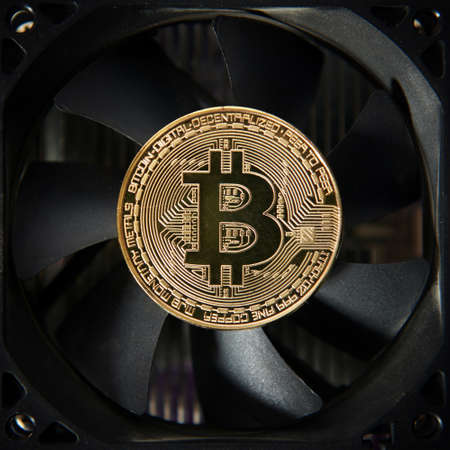 Bitcoin gold coin on coller. Virtual cryptocurrency concept