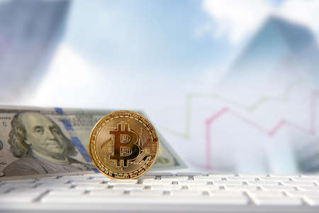 Bitcoin golden coin with financial chart and dollar background. Cryptocurrency