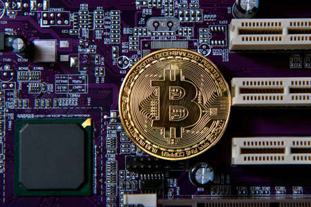 Gold Bitcoin electronic computer processor board. Virtual cryptocurrency concept
