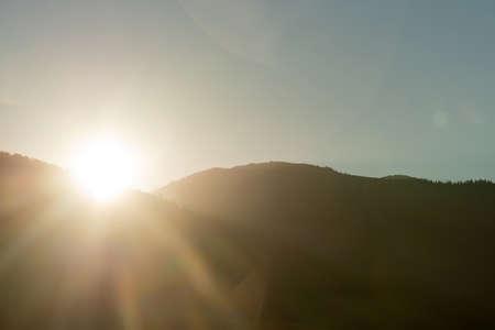 Sunny autumn mountain scene with morning sun ray Foto de archivo - 131288874