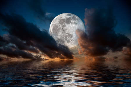 Magical evening on the sea. Big full moon reflection in water