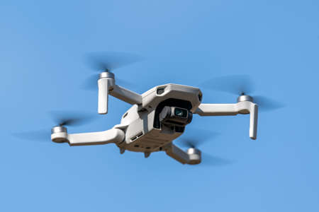 Drone Quadcopter during flight on a sunny day on blue sky background