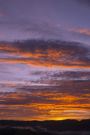 Sunrise clouds and mountains in Guatemala, dramatic sky with striking colors. Tropical area in central america.