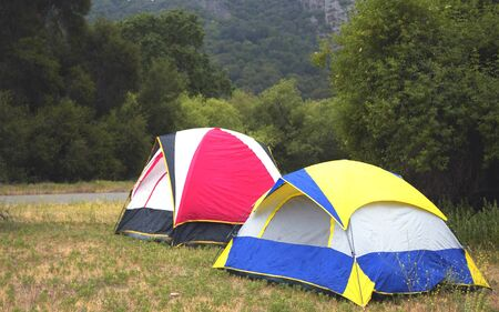 blue, red, yellow tents in the mountains