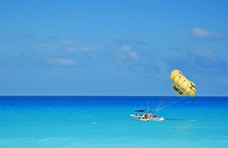 tourism in belize: parasailing in cancun
