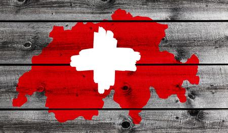 Swiss Cross on wood Standard-Bild - 115924427