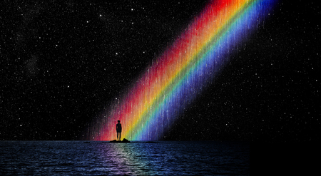 Woman standing before a rainbow