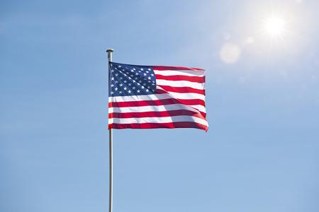 American flag in blue sky Stok Fotoğraf