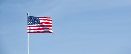 American flag in blue sky 版權商用圖片