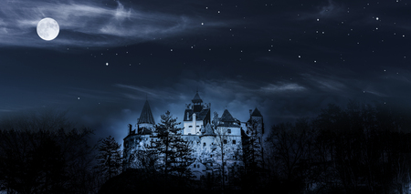 Dracula Castle at night with full moon Stock Photo