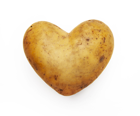 Potato heart isolated on white background Banco de Imagens