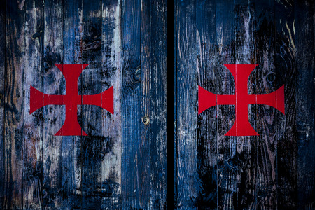 Red cross on old wooden wall