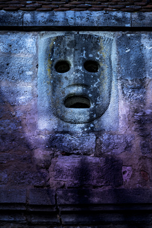 Historic stone mask in purple and blue Standard-Bild