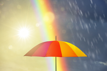 umbrella at a rainy day with rainbow