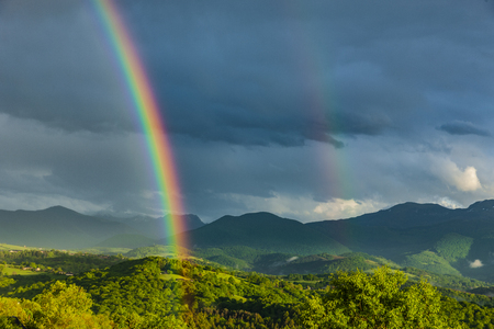 Colorful Rainbow in the French Pyrenees Stock Photo