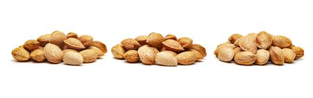 A handful of almonds isolated on white background