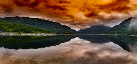 Evening red on the sognefjord with water reflection