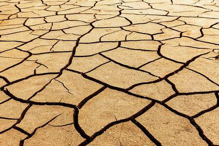 A lot of Cracks in dry soil on ground Reklamní fotografie - 127332830