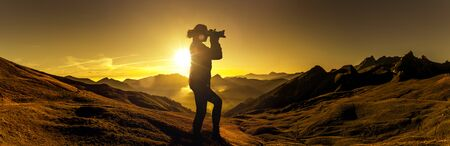 Photographer at sunrise in the mountains Silhouette Stok Fotoğraf